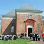 Attendees to ceremony on church lawn