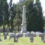 Some graves inside walled cemetery are identified with markers