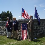 Plaque was veiled with Rev War era flag with Star Spangled Banner flag above