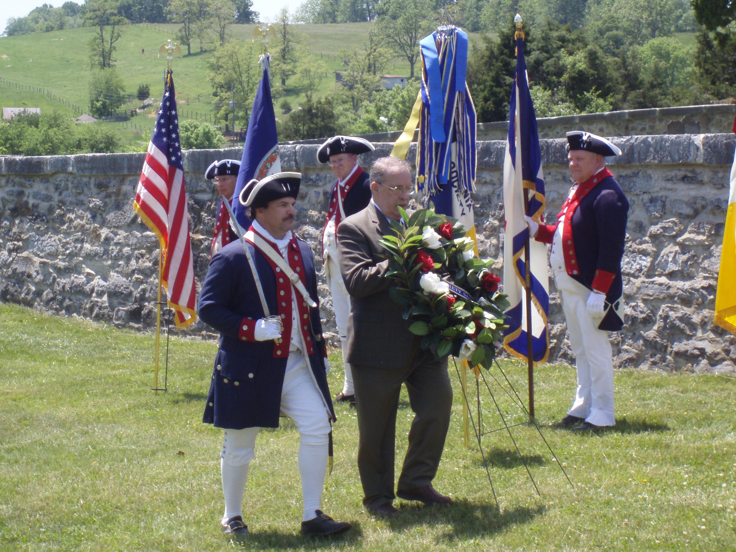 President of VASSAR, Bob Bowen presents wreath