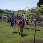 President Thadeus Hartman, 1812 Society lays wreath