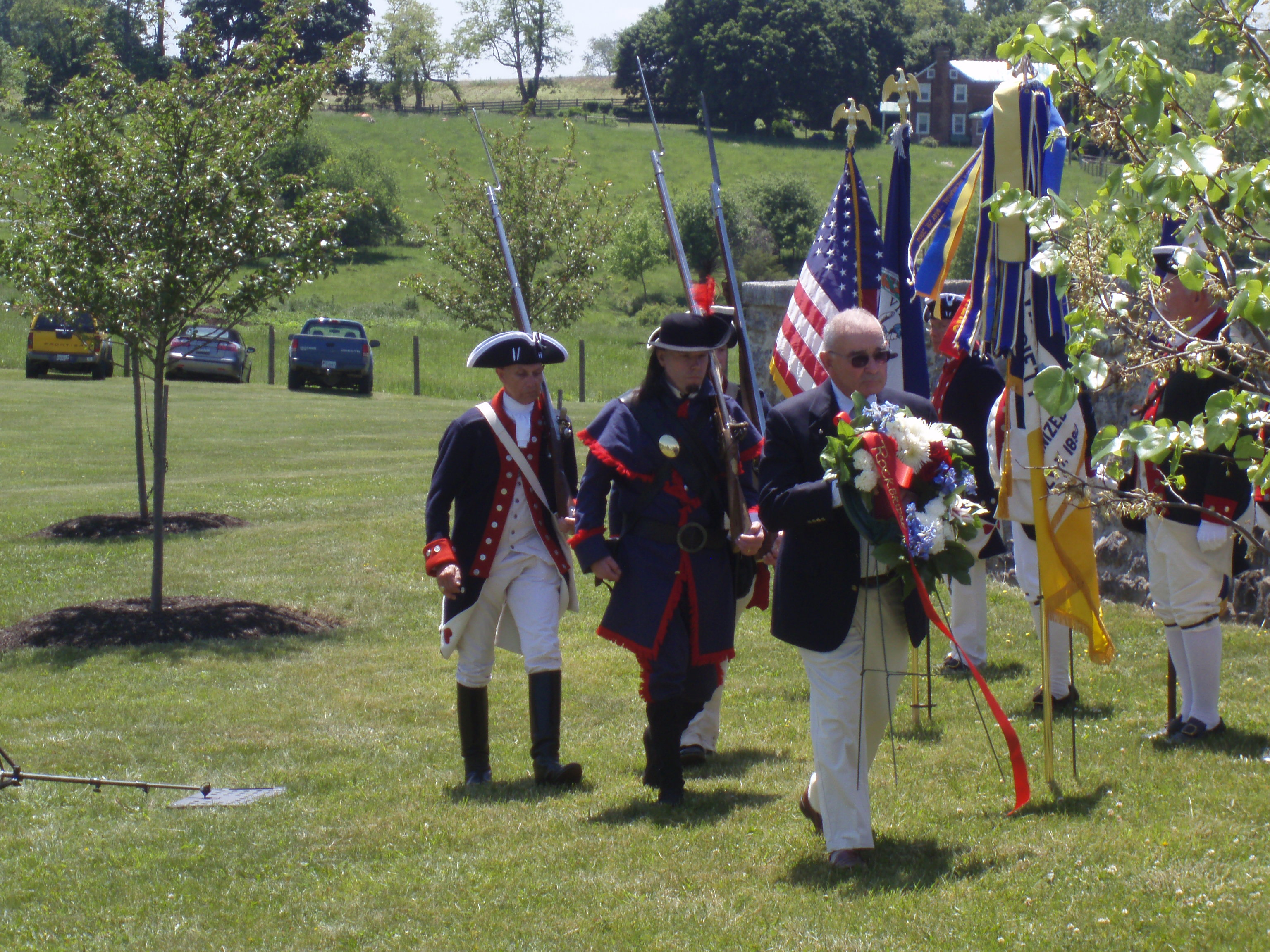 Wreath presenters are escorted by color guard