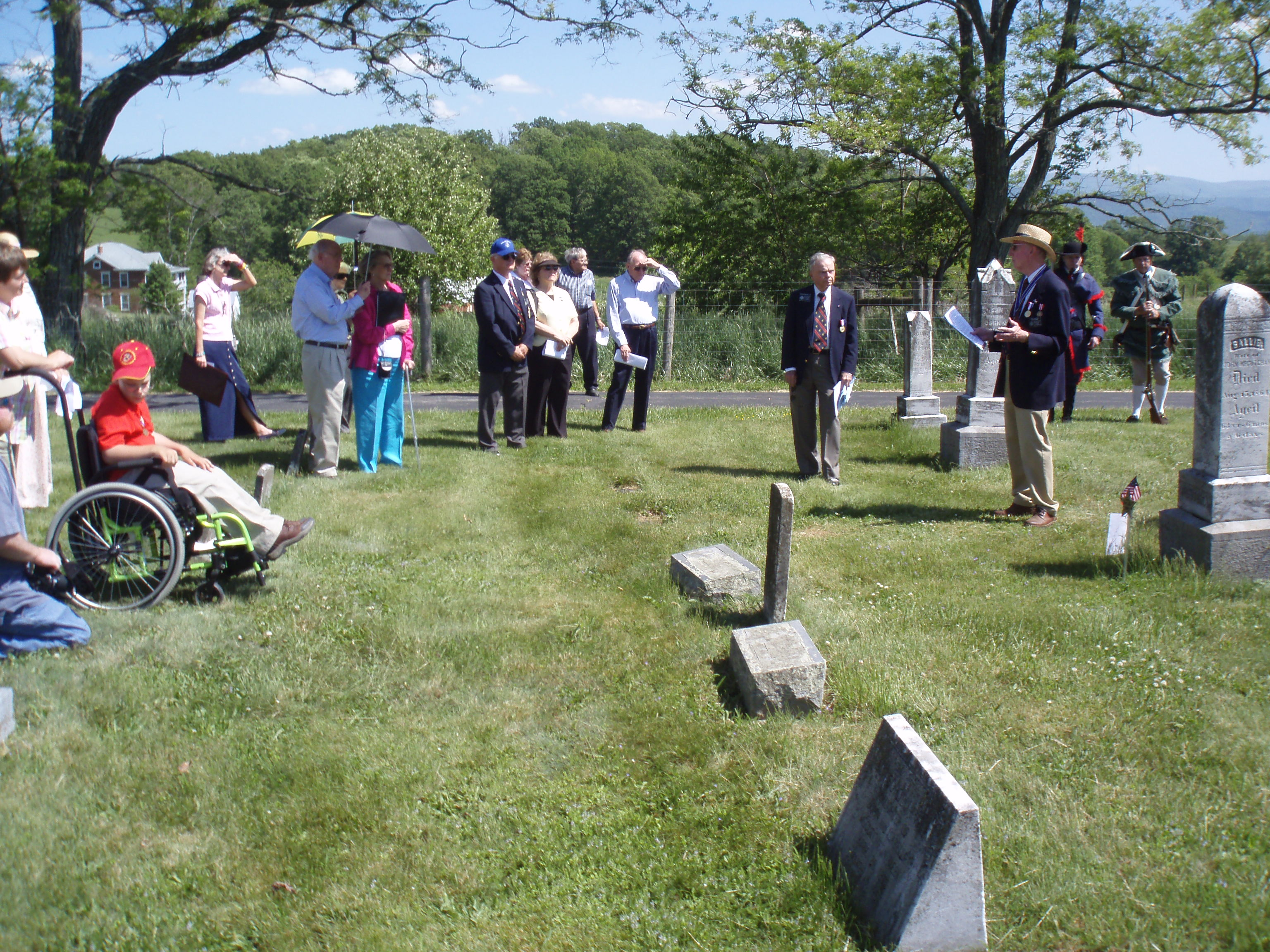 President Hartman presides at upper cemetery ceremony